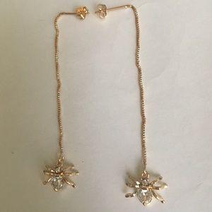 Gold spider earrings
